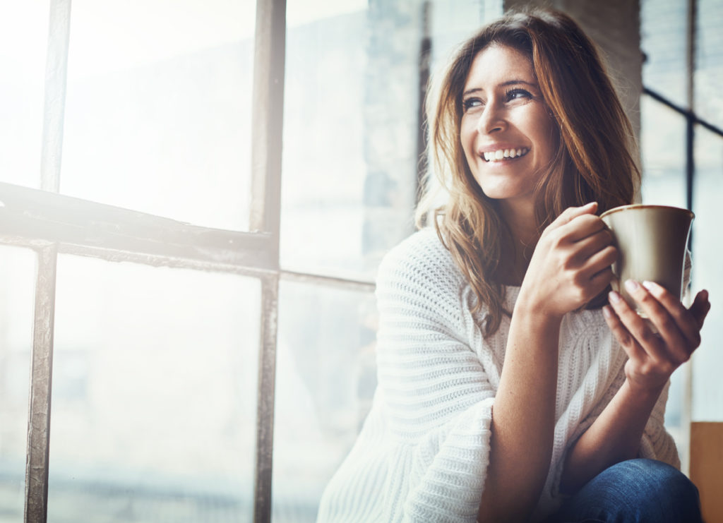women drinking coffee for self care